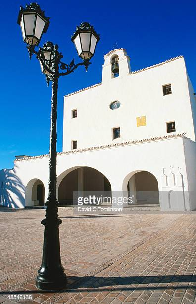 Sant Josep de Sa Talaia, whitewashed village church, lamp post in foreground.