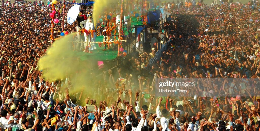 Sant Shri Asaram Bapu sprinkling colored water on his thousands of followers as part of Holi celebrations in Kumbh Mela on March 9, 2013 in Allahabad, India. The mega religious fair, held once in 12 years, last official bathing on 'Maha Shivratri' on March 10, 2013.