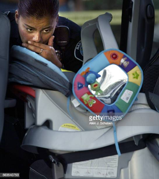 Santa Ana police officer Irene Gomez investigates a Plymouth Voyager mini–van where a five–month–old baby girl died after being left in a hot car for...