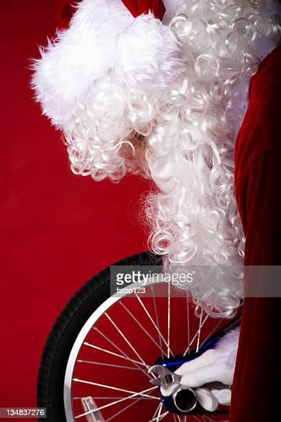 Santa and bicycle Christmas present. Assembling.