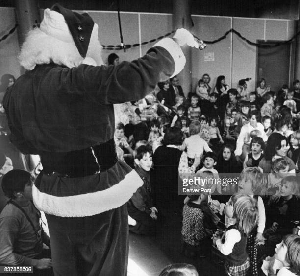 Santa Arrives At Hospital Party Santa Claus enters the auditorium at Children's Hospital with a 'ho ho ho' and a jingling of bells Friday as several...