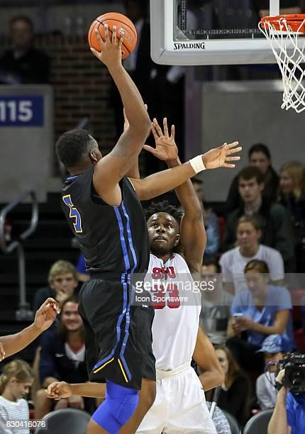 Santa Barbara forward Jalen Canty takes a shot over SMU forward Semi Ojeleye during the NCAA men's basketball game between SMU Mustangs and UC Santa...