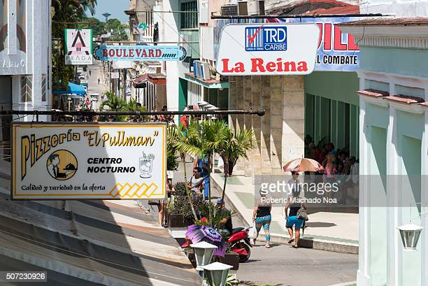 Santa Clara boulevard view with shops and restaurant signs and people in their daily routine Santa Clara built in 1689 is the capital city of the...
