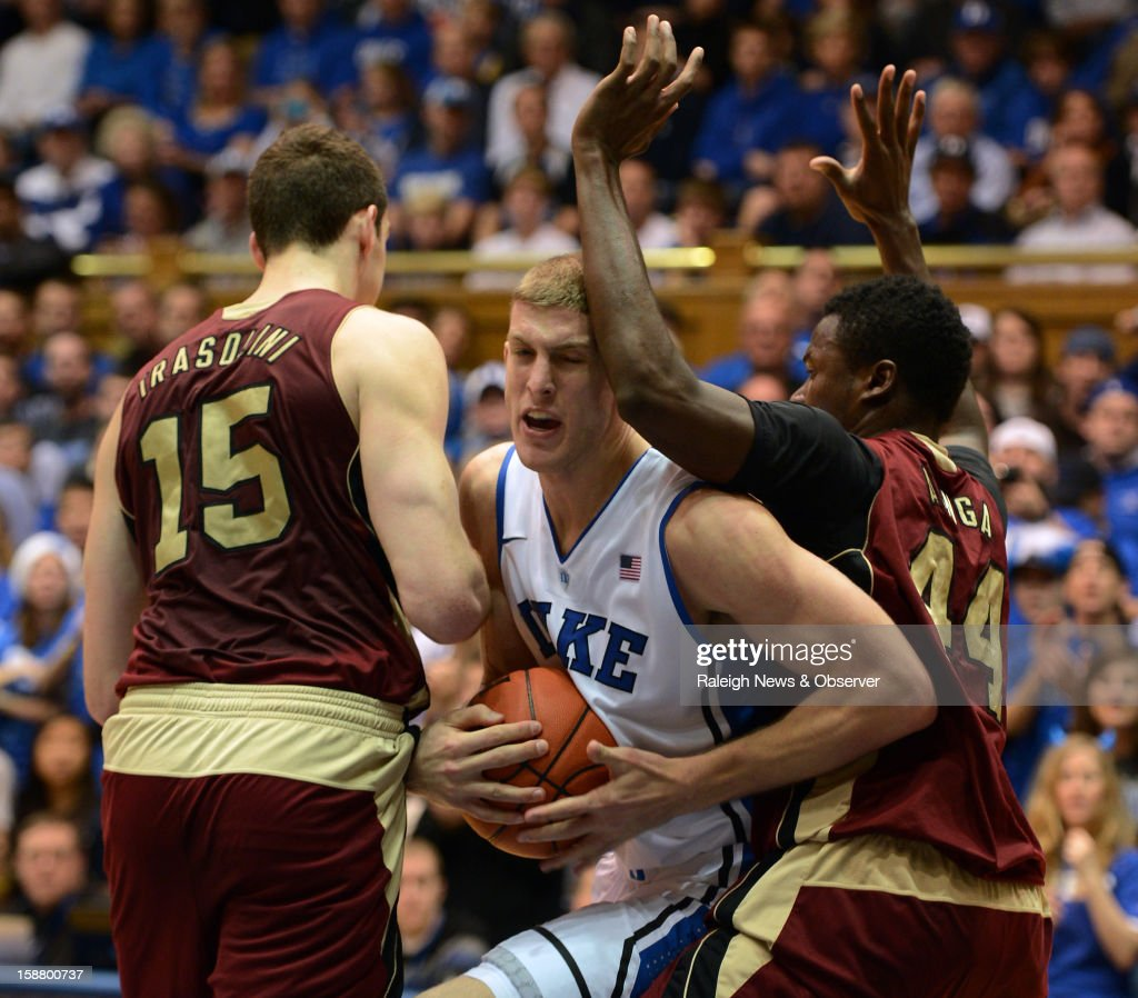 Santa Clara forward Marc Trasolini (15) and forward Yannick Atanga (44) attempt to slow Duke forward Mason Plumlee (5) as he moves towards the basket in the first half at Cameron Indoor Stadium in Durham, North Carolina, Saturday, December 29, 2012. Duke beat Santa Clara, 90-77.