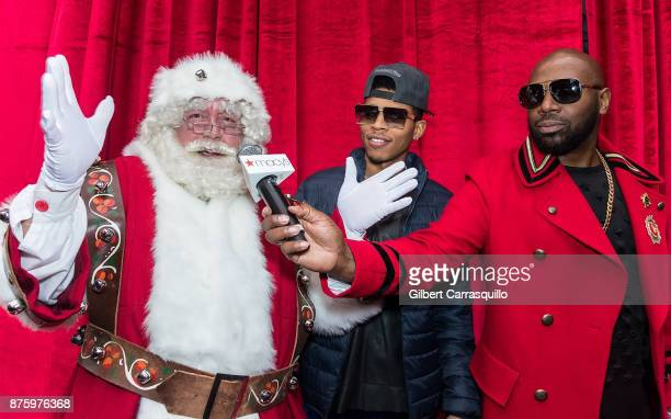 Santa Claus actor Bryshere Y Gray and comedian Buckwild attend Macy's Center City Celebrates Its Annual Holiday Window Unveiling And Family Fun Day...