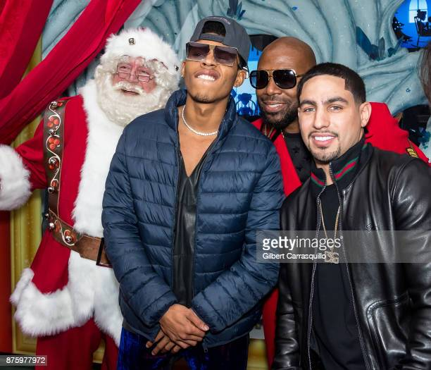 Santa Claus actor Bryshere Y Gray comedian Buckwild and professional boxer Danny Garcia attend Macy's Center City Celebrates Its Annual Holiday...