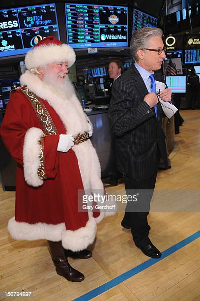 Santa Claus and CNBC anchor Bob Pisani seen on the floor of the New York Stock Exchange on November 21 2012 in New York City