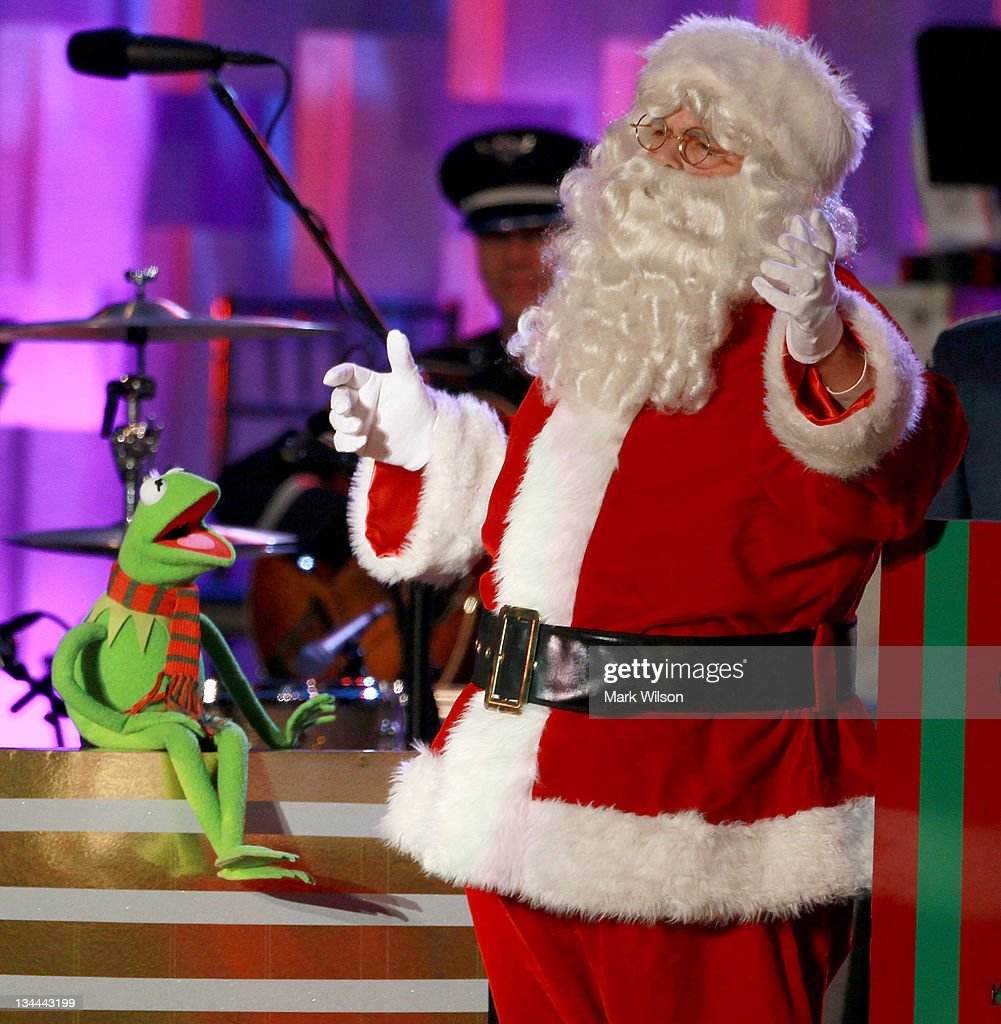 Santa Claus and Kermit the frog sing a song during the National Christmas Tree lighting ceremony, on December 1, 2011 at the Ellipse, south of the White House, in Washington, DC. The first family participated in the 89th annual National Christmas Tree Lighting Ceremony.