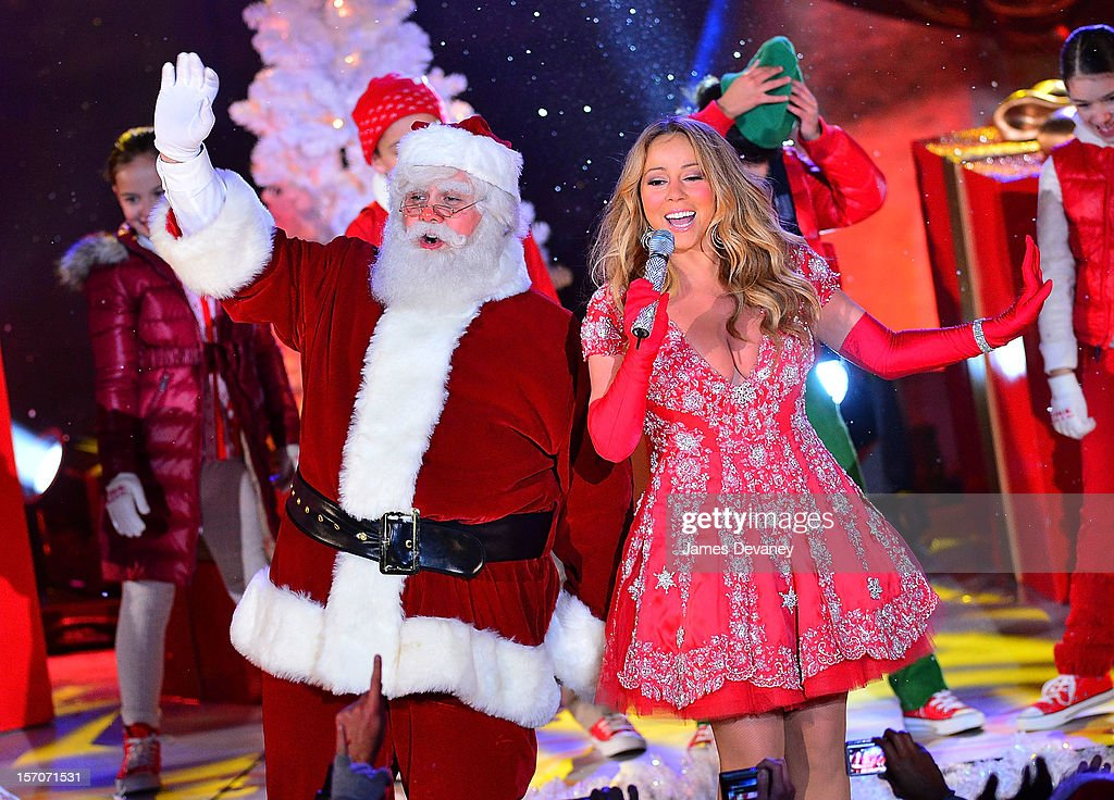 Santa Claus and <a gi-track='captionPersonalityLinkClicked' href=/galleries/search?phrase=Mariah+Carey&family=editorial&specificpeople=171647 ng-click='$event.stopPropagation()'>Mariah Carey</a> perform during a pre-tape performance for NBC's Christmas tree lighting at Rockefeller Center on November 27, 2012 in New York City.
