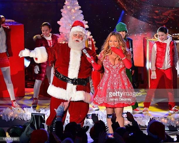 Santa Claus and Mariah Carey perform during a pretape performance for NBC's Christmas tree lighting at Rockefeller Center on November 27 2012 in New...