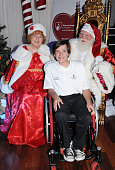 Santa Claus and Mrs Claus pose for a photo with a respresentative from Shriners Hospital at EcoLuxe Lounge #ChristmasinSeptember Presented By...
