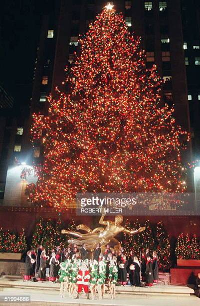 Santa Claus and the Radio City Music Hall Rockettes celebrate the lighting of the Rockefeller Center Christmas tree 05 December in New York The...