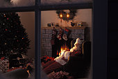 Santa Claus Asleep In Front Of Fireplace
