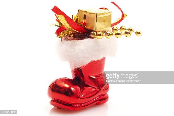 Santa Claus boot with gifts, close-up