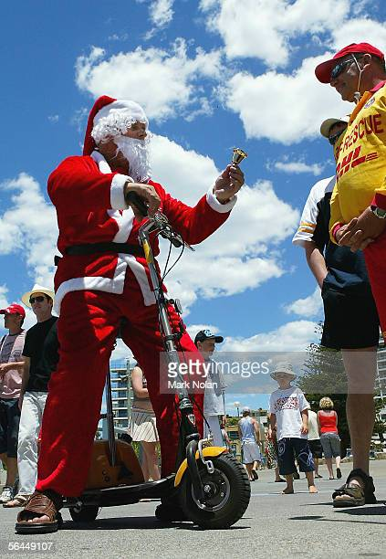Santa Claus brings much needed Christmas cheer to people at North Cronulla Beach December 18 2005 in Sydney Australia 1500 police are patroling...