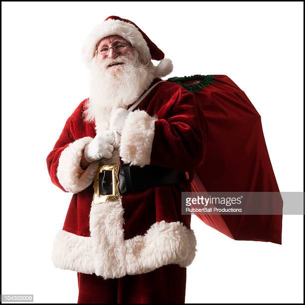 santa claus carrying a bag of presents