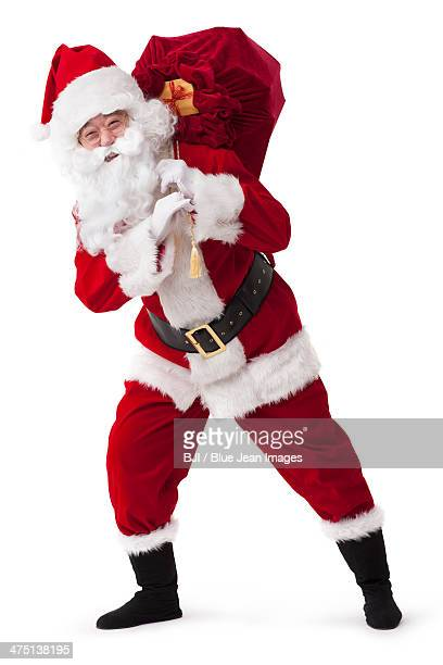 Santa Claus carrying sack of gifts