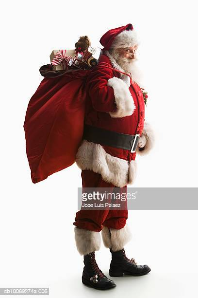 Santa Claus carrying sack of gifts, portrait, close-up