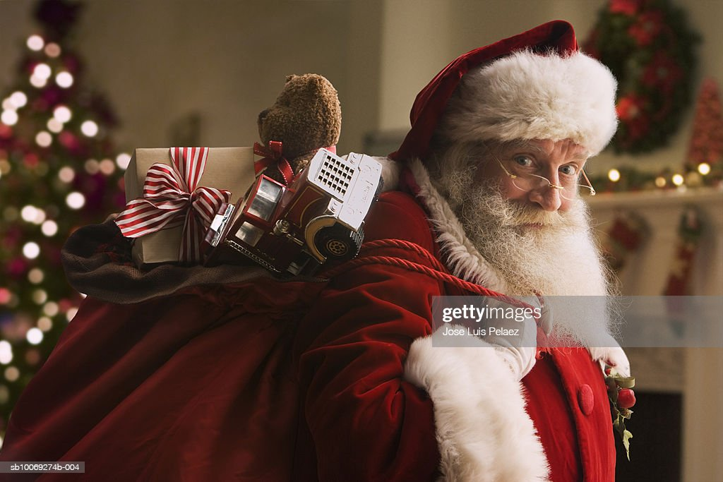 Santa Claus carrying sack of gifts, portrait, close-up : Stock Photo