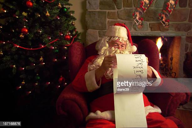 Santa Claus checking his Christmas list.
