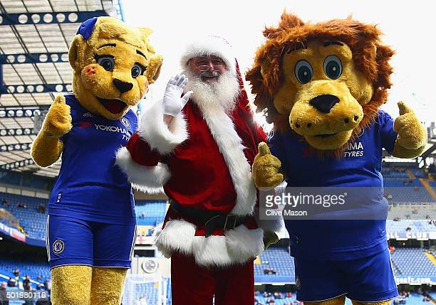 Santa Claus Chelsea mascots Stamford the Lion and Bridget the lioness are seen prior to the stadium prior to the Barclays Premier League match...
