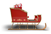 Santa Claus sleigh with sack full of Christmas gifts on a white background with clipping path.