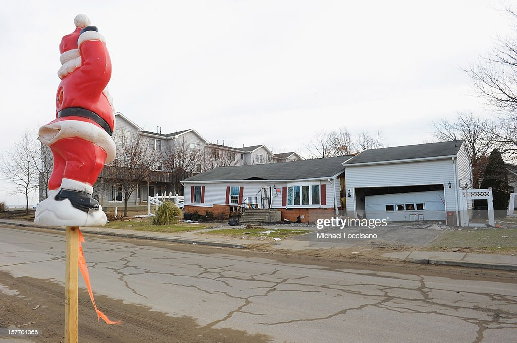 A Santa Claus decoration is put up in front of a house devastated by Superstorm Sandy a month prior on December 5, 2012 in Union Beach, New Jersey. With a population of 6,200, roughly 1,000 homes were flooded and 200 rendered inhabitable.