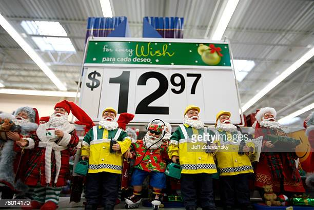Santa Claus figurines are dispalyed at the WalMart store November 20 2007 in Secaucus New Jersey The holiday shopping season 'officially' starts...