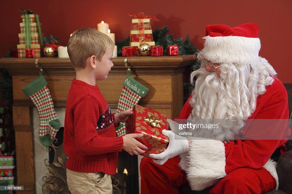Santa claus gives gifts on christmas