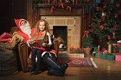 Santa Claus giving girl a gift