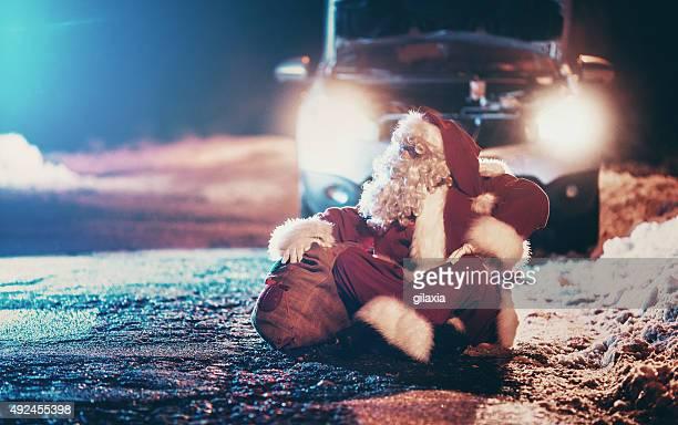Santa Claus having car trouble.