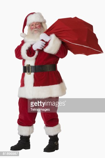 Santa S Bag Of Toys : Santa claus holding bag of toys stock photo getty images