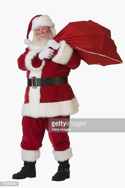 Santa Claus holding bag of toys