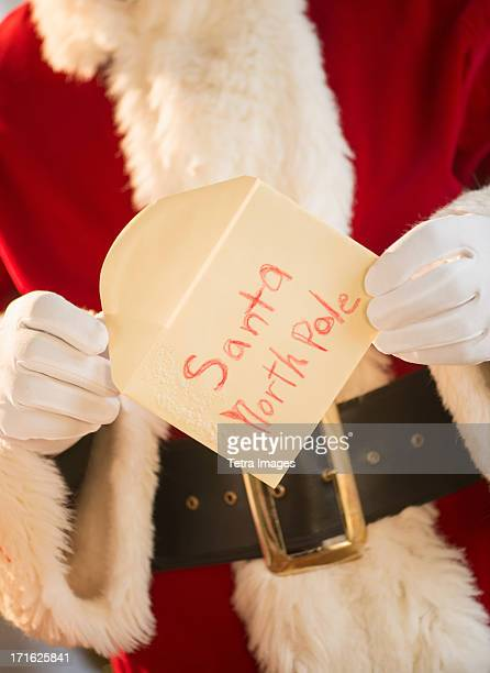Santa claus holding letter