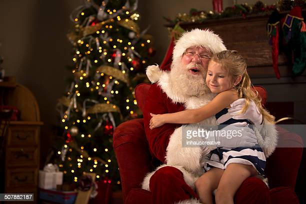 Santa Claus hugging a child