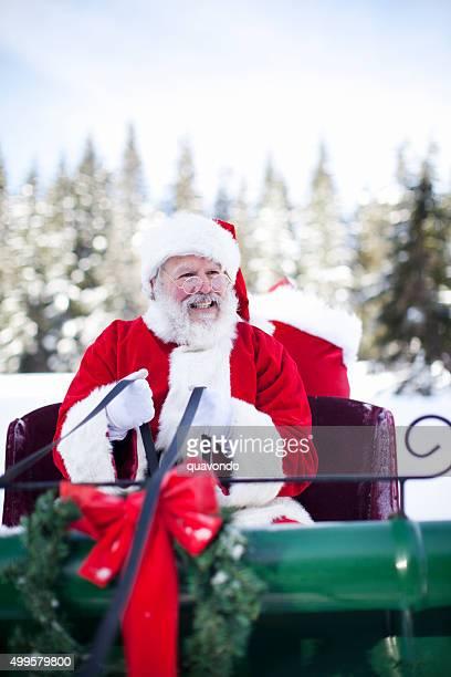 Père Noël dans son traîneau au Pôle Nord