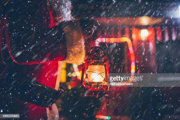 Santa Claus is lighting his way through a snowstorm