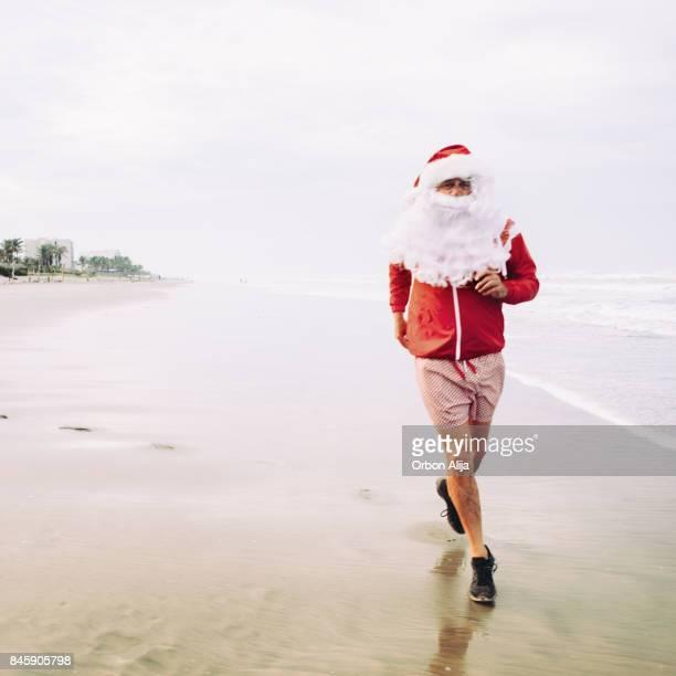 Santa Claus Jogging on beach