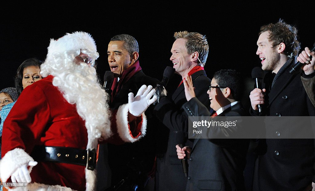 Santa Claus joins U.S. President Barack Obama with actor Neil Patrick Harris, Rico Rodriguez, actor on Modern Family, and Phillip Phillips, winner of 'American Idol' Season 11, during the 90th National Christmas Tree Lighting Ceremony on the Ellipse behind the White House on December 6, 2012 in Washington, DC. This year is the 90th annual National Christmas Tree Lighting Ceremony.