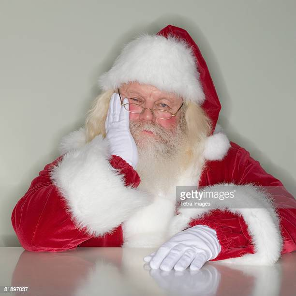 Santa Claus leaning on table