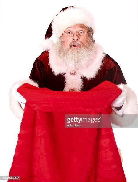 Babbo Natale alla ricerca nel sacco di regali