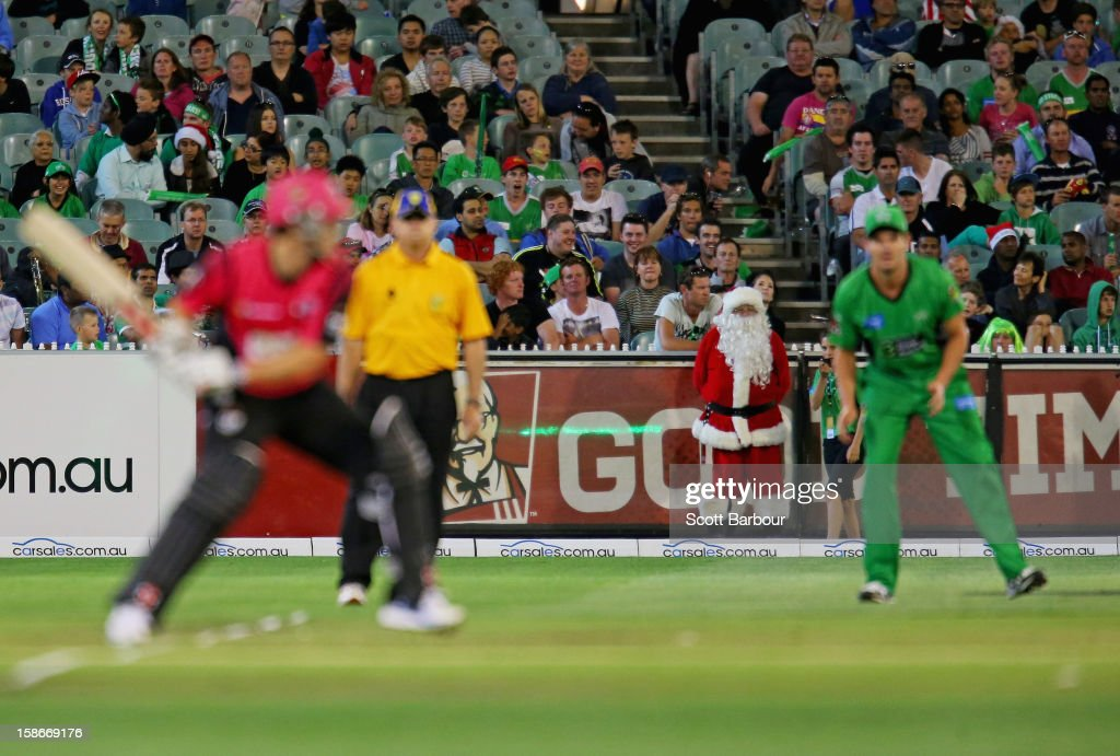 Santa Claus looks on from the boundary during the Big Bash League match between the Melbourne Stars and the Sydney Sixers at Melbourne Cricket Ground on December 21, 2012 in Melbourne, Australia.