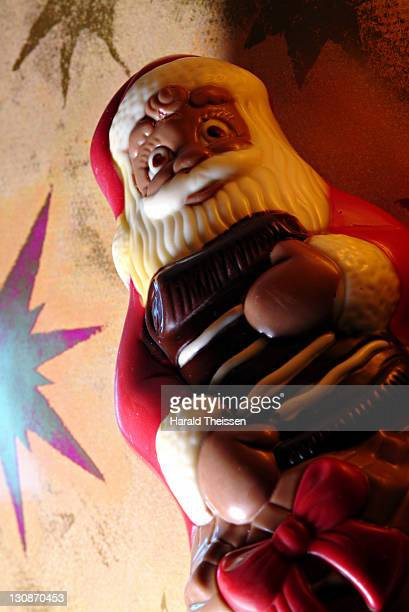Santa Claus made of chocolade in front of stars