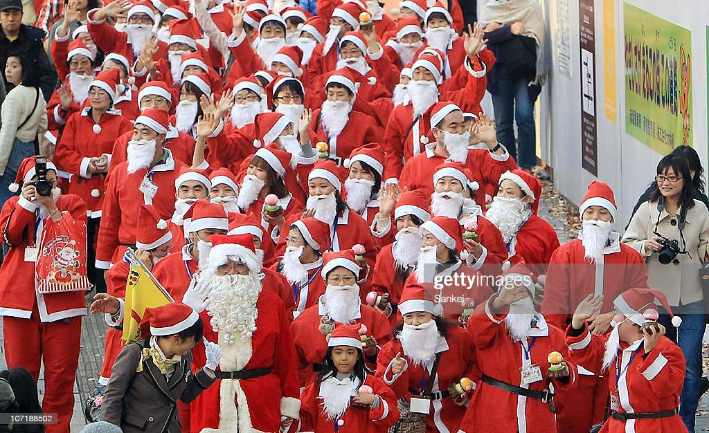 77 Santa Claus march on the street in the shopping district of Harajuku on November 28, 2010 in Tokyo, Japan. The participants of 'Santa Claus Academy' walks on the street and visit famous toy shop 'Kiddyland' to research Christmas gifts.