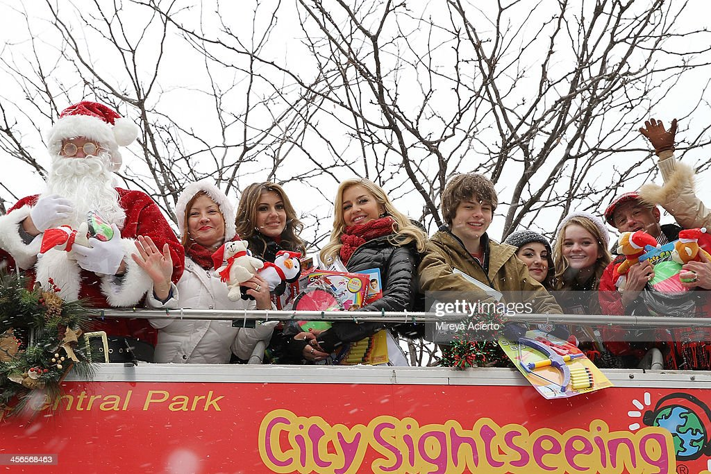 Santa Claus, Mrs. Claus, <a gi-track='captionPersonalityLinkClicked' href=/galleries/search?phrase=Erin+Brady+-+Miss+USA+2013&family=editorial&specificpeople=11009508 ng-click='$event.stopPropagation()'>Erin Brady</a>, <a gi-track='captionPersonalityLinkClicked' href=/galleries/search?phrase=Cassidy+Wolf&family=editorial&specificpeople=10468223 ng-click='$event.stopPropagation()'>Cassidy Wolf</a>, Brendan Meyer, Juliette Goglia, Kerris Dorsey and Anthony Laciura attend CitySightseeing New York 2013 holiday toy drive at PAL's Harlem Center on December 14, 2013 in New York City.