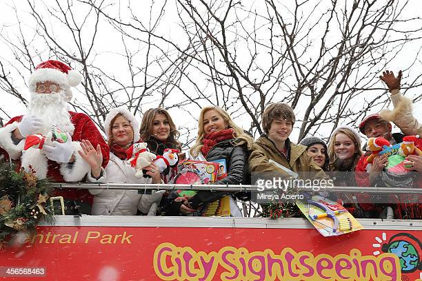 Santa Claus Mrs Claus Erin Brady Cassidy Wolf Brendan Meyer Juliette Goglia Kerris Dorsey and Anthony Laciura attend CitySightseeing New York 2013...