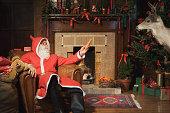 Santa Claus offering a deer a carrot