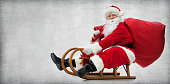Santa Claus on his sledge with a bag full of Christmas gifts