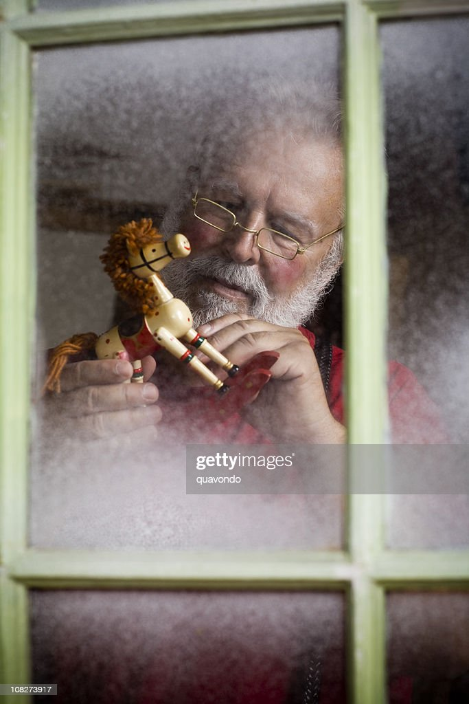 Busy Santa Claus Making Christmas Toys in Workshop, Copyspace : Stock Photo