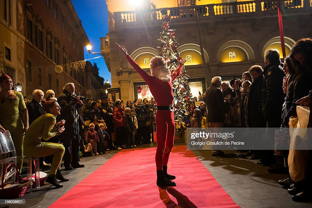 Santa Claus poses for pictures after a Christmas show in front of the Fendi Palace in downtown area on December 8, 2012 in Rome, Italy.